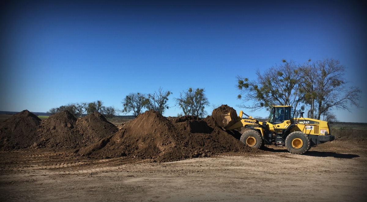 Topsoil with loader